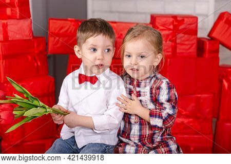 Love, Friendship Kids And Fun. Valentine Day, Holiday, Celebration. Boy And Girl Hugging. Two Happy