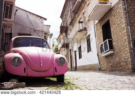 Ohrid, North Macedonia - May 5, 2021. Pink Retro Old Car On The Street Of The Ancient City Of Ohrid,