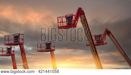 Articulated Boom Lift. Aerial Platform Lift. Telescopic Boom Lift With Sunset Sky. Mobile Constructi