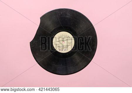 Old Damaged  Vinyl Record With The Popular Soviet Song Let's Never Quarrel, Sings Tamara Miansarova.