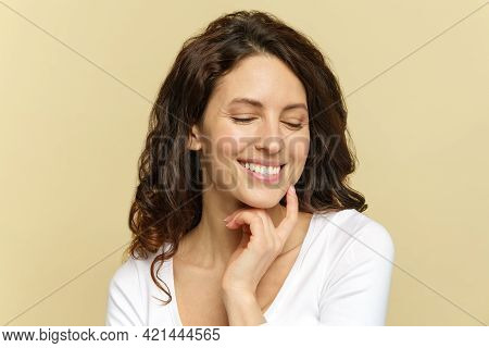 Skin Care. Happy Woman With Beautiful White Smile Touching Clear Pure Face, Enjoy Fresh Face After S
