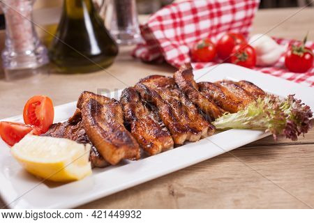 Close Up Of Delicious Boned Ribs Served On Table