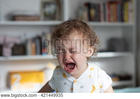 Little Girl Crying. One Year Old Baby Crying At Home