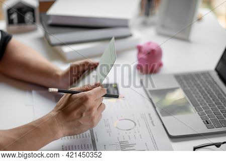 Saving And Growth Money Concept Bookkeeper Using Calculator, Laptop Computer And Holding Passbook To