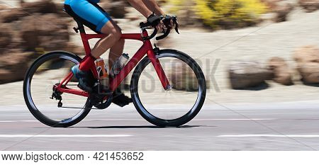 Road Bike Cyclist Man Cycling, Athlete On A Race Cycle. Panning Technique Used