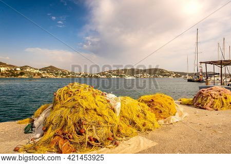 Colorful Yellow And Orange Traditional Fishing Nets At The Pier In Finikas Marina, Greece, With Amaz