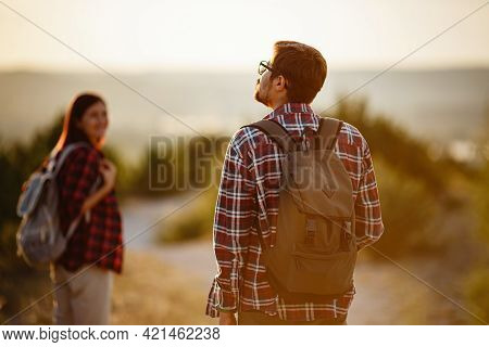 Portrait Of Happy Young Couple Having Fun On Their Hiking Trip. Caucasian And Asian Hiker Couple Enj