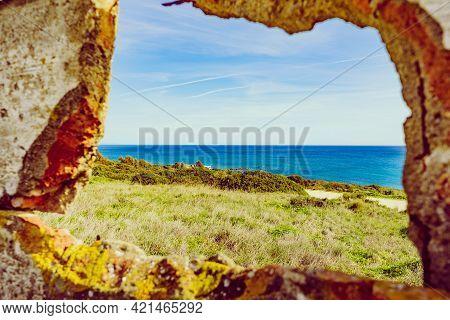 View From Stone Frame Of Sea Landscape. Mediterranean Coast, Beach Torrecarbonera On Punta Mala, Alc