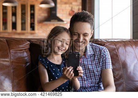 Happy Daddy And Daughter Kid Watching Content On Mobile Phone