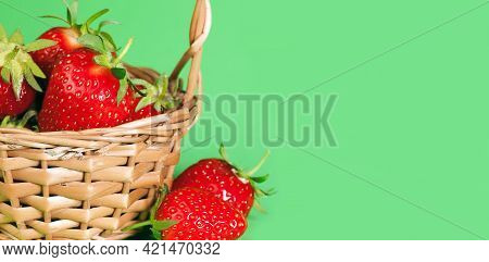 Fruit Background. Red Berries Strawberries In A Basket On A Green Background.strawberries Close-up.