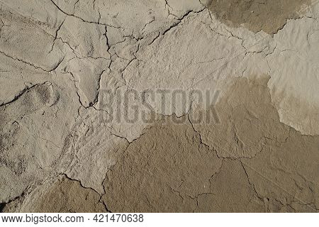 Cracked Earth Soil Ground Texture Background. Mosaic Pattern Of Wet Mud Clay Earth And Sand, Top Vie