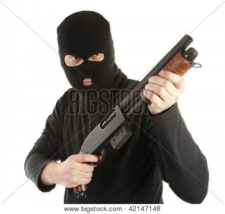 Masked man aims with rifle