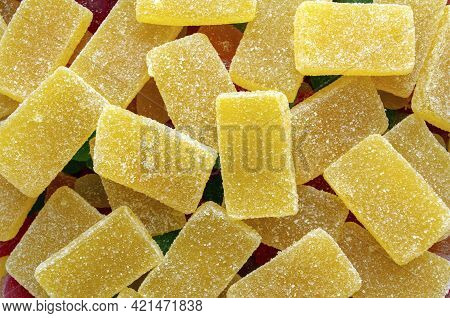 Yellow Rectangular Jelly Candies Pattern Background. Yellow Rectangular Shaped Marmalade Backdrop
