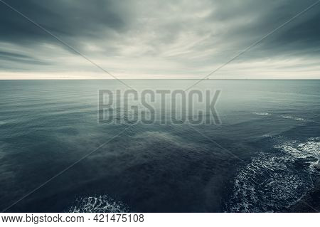 Dramatic Seascape, Dark Blue Clouds And Sea Or Ocean Water Surface, Time Before Storm.