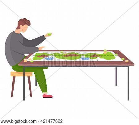 Man Sitting On Chair Next To Table With Colored Board Game And Coins. Male Character Has Interesting
