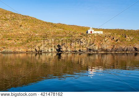 Old White Abandoned Church Agios Ioannis On Dramatic Cliff On Kithnos Island, Greece, Seen From The