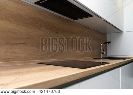 Modern Kitchen Interior With Induction Hob And Faucet With Sink