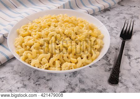 Macaroni And Cheese On A White Plate On A Gray Background. American Mac And Cheese