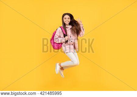 Teen Girl Jump In Checkered Shirt. Happy Kid Run With Backpack. Tween Child Carry School Bag.