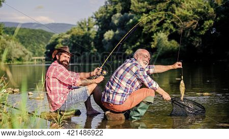 Retired Father And Mature Bearded Son. Big Game Fishing. Relax On Nature. Fly Fish Hobby Of Men. Ret