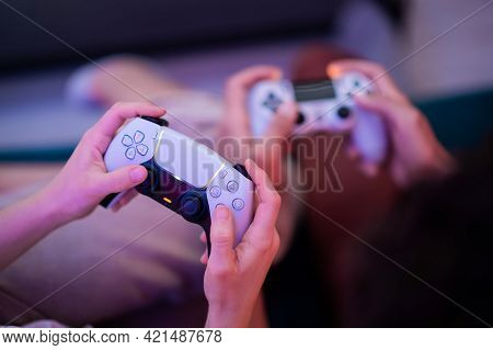 Different Generations Of Playstation Console Controllers: Ps5 Dualsense Controller And Ps4 Dualshock