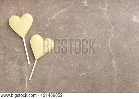 Chocolate Heart Shaped Lollipops On Light Grey Marble Table, Flat Lay. Space For Text
