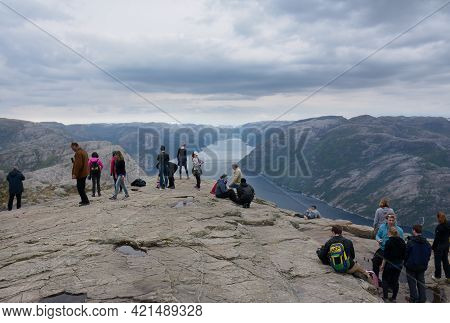Rogaland, Norway - 23rd May, 2017: Hikers Enjoying The Beautiful Views Of The Lysefjord On An Overca