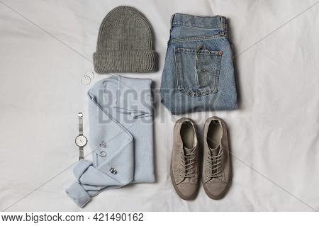 Stylish Look With Cashmere Sweater, Flat Lay. Women's Clothes And Accessories On Fabric