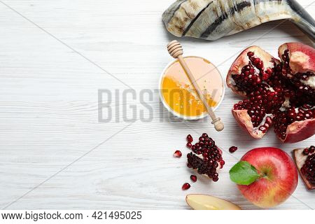Honey, Pomegranate, Apples And Shofar On White Wooden Table, Flat Lay With Space For Text. Rosh Hash