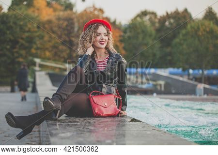 Happy Fashionable Woman With Red Handbag And French Beret Outdoor