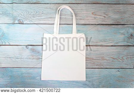 Tote Bag Canvas Fabric Cloth Shopping Sack Mockup Blank Template Isolated On Wooden Background. Stoc