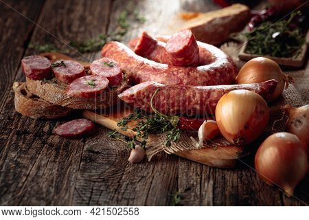Dry-cured Sausages With Herbs And Spices. Sausages With Bread, Thyme, Pepper, Onion, And Garlic On A