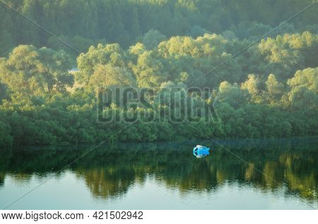 Forest summer landscape - birds eye view of picturesque forest nature and forest river under soft early morning sunlight. Morning view of forest summer nature, forest landscape, forest river in the morning