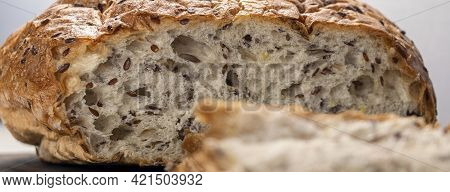 Banner With Close Up Sliced Bread On Serving Board With Flax And Sunflower Seeds. Fresh, Tasty, Roun