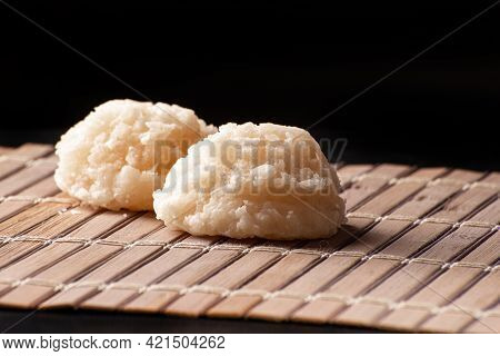 Cocada, Coconut Candy From Brazil, White Cocadas On Wooden Mat, Black Background, Selective Focus.