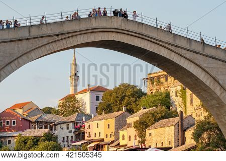 Mostar, Bosnia and Herzegovina - August 30, 2019: Stari Most bridge at sunset in old town of Mostar, Bosnia and Herzegovina
