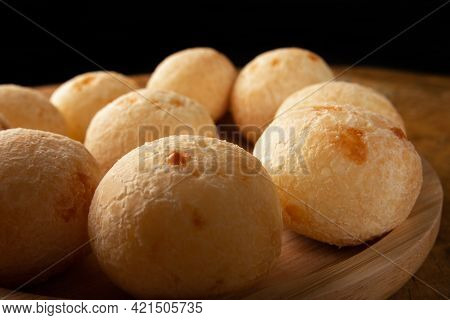 Brazilian Cheese Bread, Cheese Breads Arranged On Wooden Plate, On Rustic Wood, Selective Focus.