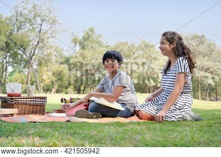 A Half-thai Indian Boy And A Half-thai-european Girl Friend Learning Outside Of School In The Park
