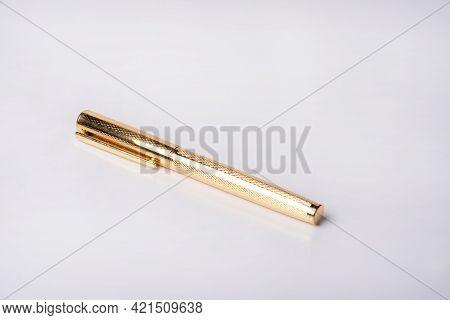 Fountain Pen, Beautiful Golden Fountain Pen On White Background, Selective Focus.