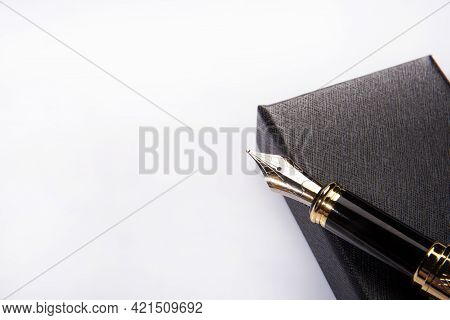 Fountain Pen, Beautiful Golden Fountain Pen Over Dark Box On White Background, Selective Focus.