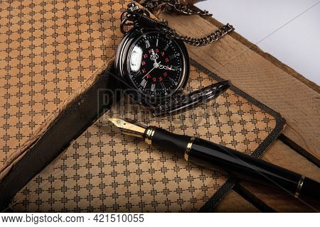 Fountain Pen, Beautiful Fountain Pen In Detail With An Old Clock On An Old Book On Rustic Wood, Sele