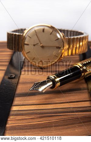 Fountain Pen, Beautiful Fountain Pen In Detail On Rustic Wood Along With An Old Clock, Selective Foc