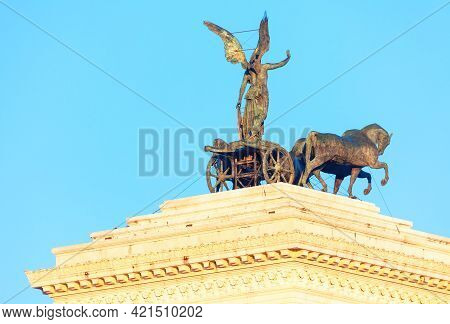 Sculpture Of Victoria Riding On The Quadriga . Chariot With Horses Sculpture On The Building Top Of