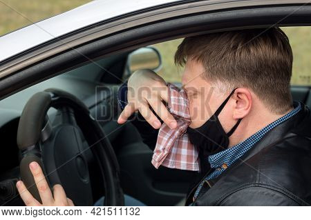 A Sick Driver In The Car Wipes His Snot With A Handkerchief.