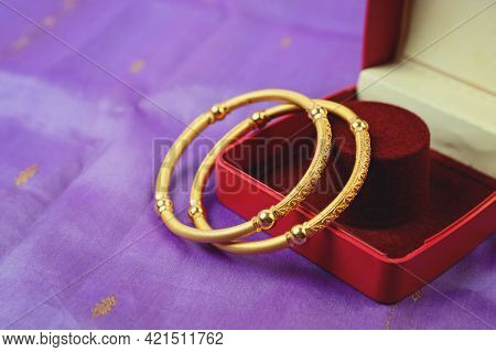 Beautiful Golden Jewellery. Bangles, Diamond Rings And Necklaces Show In Luxury Retail Store Window
