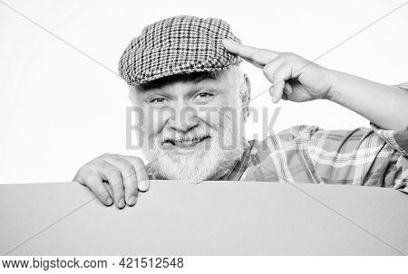 Pensioner Grandfather In Vintage Hat Hold Poster Information Copy Space. Event Announcement. Announc