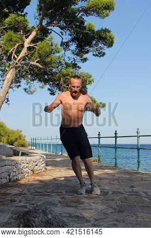 A Shot Of A Sport Mid Adult Man Jumping Outdoors
