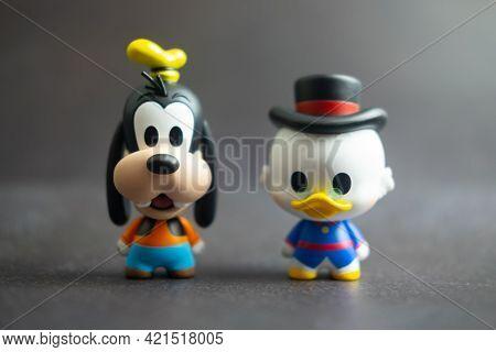Samut Prakan, Thailand - May 24, 2021 : Cute Figurine Goofy And Scrooge Mcduck, Collection Figurine