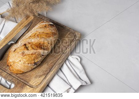 Freshly Baked, Yeast-free, Whole Wheat Flour Bread With Cranberries. Served On A Wooden Board With A