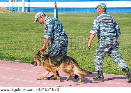 Abakan, Russia - August 21, 2018: Police Officers Training A Sniff Dog For Finding Drugs, Weapons, E
